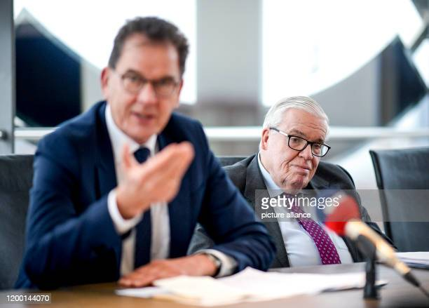 February 2020, Hamburg: Gerd Müller , Federal Minister of Development and Klaus-Michael Kühne, entrepreneur, speak to employees at the headquarters...