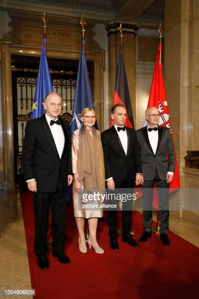 February 2020, Hamburg: Mircea Geoana , Deputy Secretary General of NATO and former Romanian Foreign Minister, Peter Tschentscher , First Mayor of...