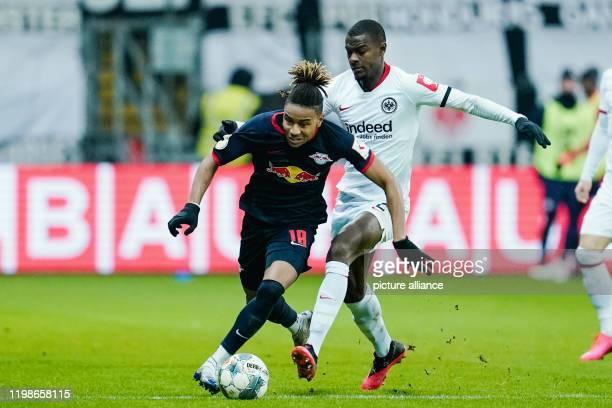 Football DFB Cup Round of 16 Eintracht Frankfurt RB Leipzig Commerzbank Arena Leipzig's Christopher Nkunku and Frankfurt's Evan Obite N'Dicka fight...