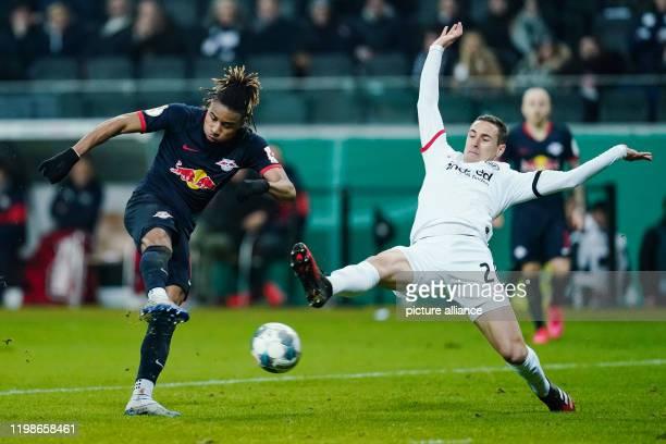 Football DFB Cup Round of 16 Eintracht Frankfurt RB Leipzig Commerzbank Arena Leipzig's Christopher Nkunku and Frankfurt's Dominik Kohr fight for the...