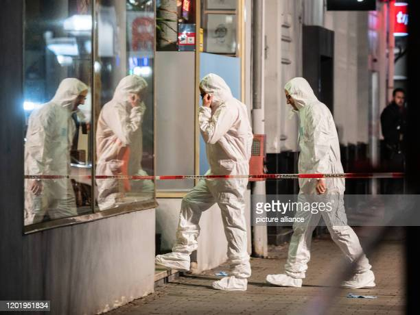 Forensics is heading towards the scene of the crime at Heumarkt Several people have been killed by gunshots in Hanau Hesse Photo Andreas Arnold/dpa