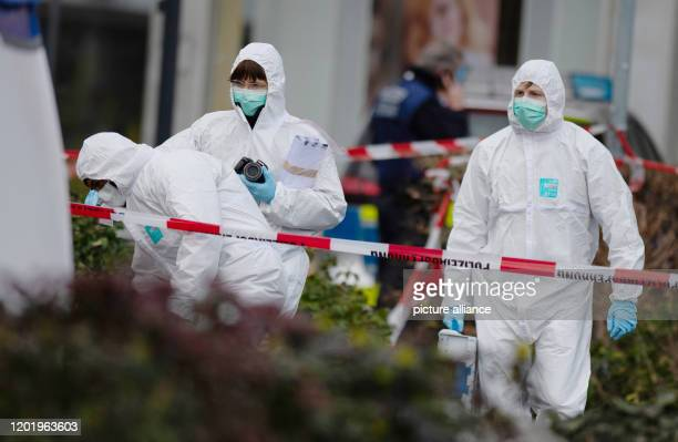 Three members of the forensics team enter a crime scene in Kesselstadt Several people were killed and others injured when shots were fired at two...