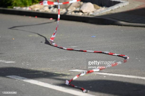 A barrier tape flutters in Volkmarsen on the road above the traces of the accident The day before a man had driven his car into a carnival parade and...