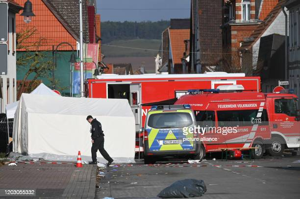 A police officer walks across the scene The day before man had raced his car into a carnival parade and injured 30 people including children The...