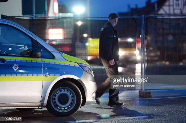A policeman walks in front of a screen in front of the place where the day before a man raced his car into a carnival parade and injured about 30...
