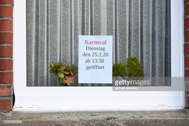 A sign in a window of a catering establishment indicates that it is open The day before a man had driven his car into a carnival parade and injured...