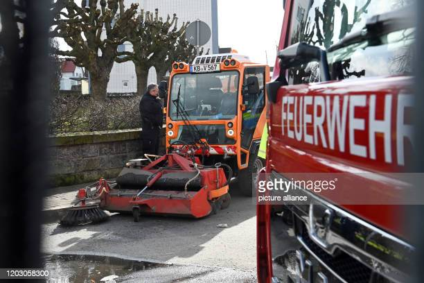 A sweeper drives along the scene behind a fire engine The day before a man had driven his car into a carnival parade and injured numerous people...