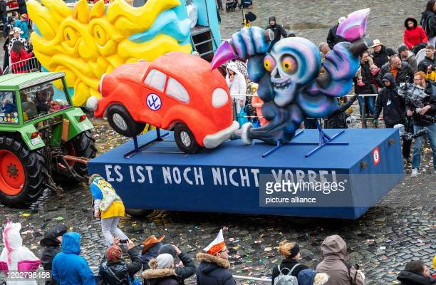 23 February 2020 Lower Saxony Brunswick Carnivalists take part in the carnival procession Schoduvel with a motif car which deals with the VW exhaust...