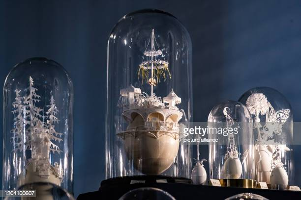 29 February 2020 Lower Saxony Fürstenberg Various eggs made of paper by the artist Leona Dollase stand under a glass bell at the Easter egg market at...