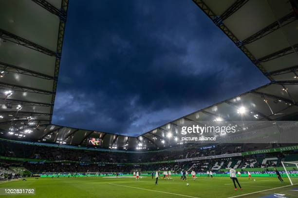 23 February 2020 Lower Saxony Wolfsburg Football Bundesliga VfL Wolfsburg FSV Mainz 05 23rd matchday in the Volkswagen Arena Dark rain clouds can be...
