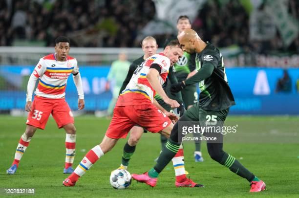 23 February 2020 Lower Saxony Wolfsburg Football Bundesliga VfL Wolfsburg FSV Mainz 05 23rd matchday in the Volkswagen Arena Wolfsburg's John Anthony...