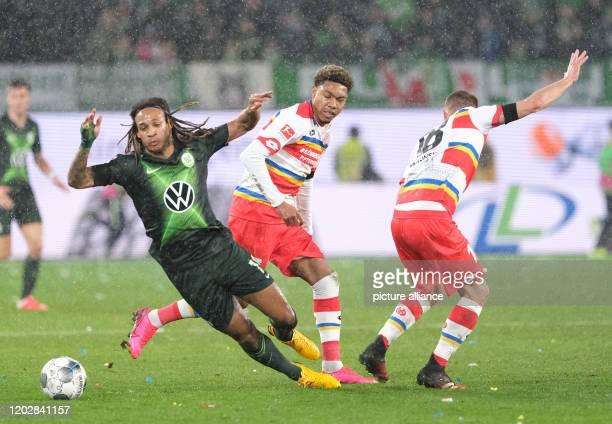 23 February 2020 Lower Saxony Wolfsburg Football Bundesliga VfL Wolfsburg FSV Mainz 05 23rd matchday in the Volkswagen Arena Wolfsburg's Kevin Mbabu...