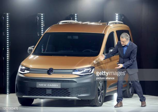 20 February 2020 North RhineWestphalia Duesseldorf Albert Kirzinger Head of Volkswagen Commercial Vehicle Design is standing next to the new VW Caddy...