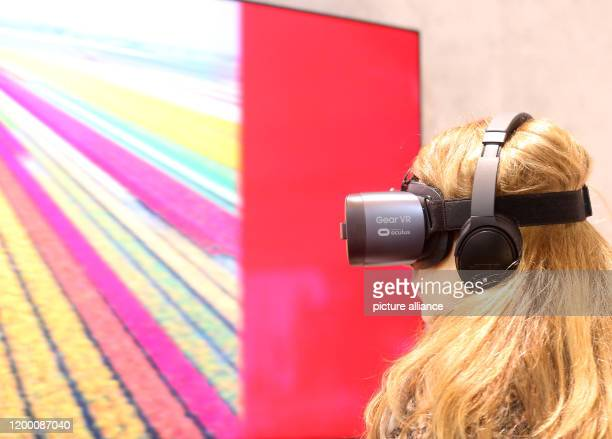 11 February 2020 North RhineWestphalia Essen A visitor to the Eon trade fair looks through 3D glasses at the Eworld 2020 trade fair to see what the...