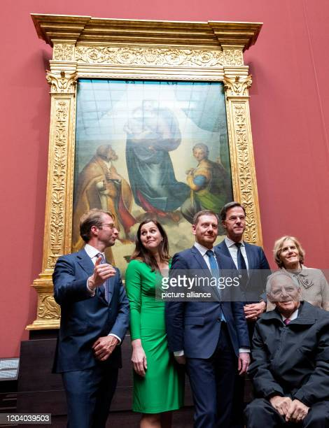 February 2020, Saxony, Dresden: Michael Kretschmer , Prime Minister of Saxony, his partner Annett Hofmann , Mark Rutte , Prime Minister of the...