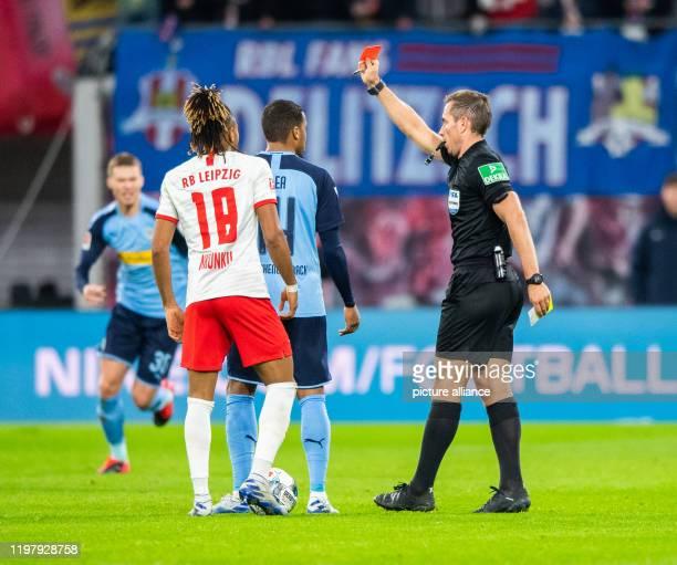 Football Bundesliga RB Leipzig Borussia Mönchengladbach 20th matchday in the Red Bull Arena Referee Tobias Stieler gives Mönchengladbach's Alassane...