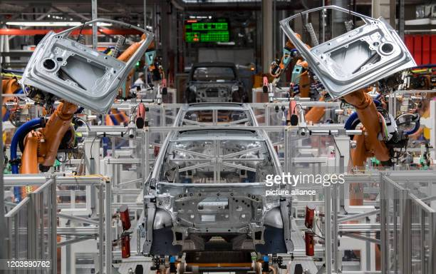 February 2020, Saxony, Zwickau: In the body shop of the Volkswagen plant in Saxony, robots assemble the doors of the VW ID.3. At the beginning of...
