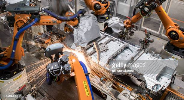 February 2020, Saxony, Zwickau: The floor assembly of the VW ID.3 runs through a production line in the body shop of the Volkswagen plant in Zwickau,...