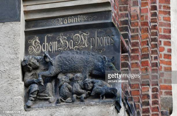 """February 2020, Saxony-Anhalt, Wittenberg: A medieval sculpture called """"Judensau"""" is on display on the outer wall of the town church of St. Marien in..."""