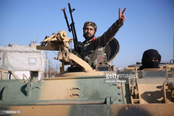 Turkishbacked Syrian fighters mobilize in the village of alMastumah for military action against the Syrian regime after the escalation and progress...