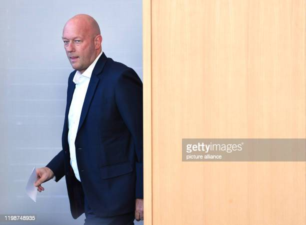Thomas Kemmerich leader of the FDP parliamentary group in the state parliament comes out of the voting booth during the election of the new prime...
