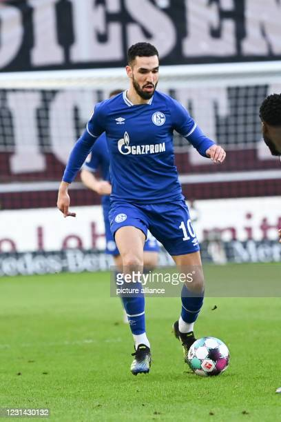 February 2021, Baden-Wuerttemberg, Stuttgart: Football: Bundesliga, VfB Stuttgart - FC Schalke 04, Matchday 23, Mercedes-Benz Arena. Schalke's...