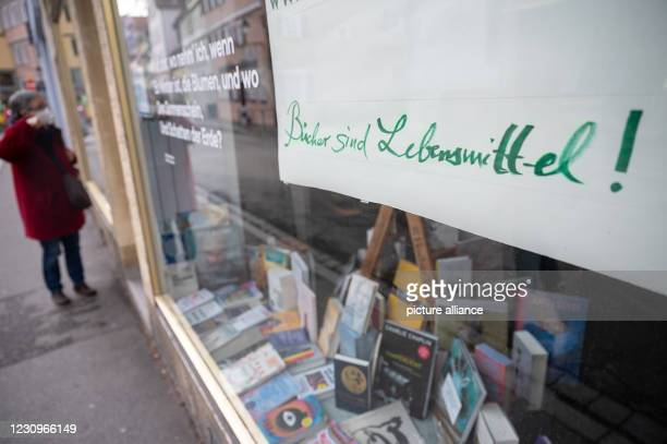 """February 2021, Baden-Wuerttemberg, Tübingen: """"Books are food"""" is written on a bookstore that is only allowed to be open for pickups due to the..."""
