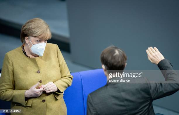 February 2021, Berlin: Federal Chancellor Angela Merkel and Karl Lauterbach attend the plenary session of the German Bundestag. The main topics of...