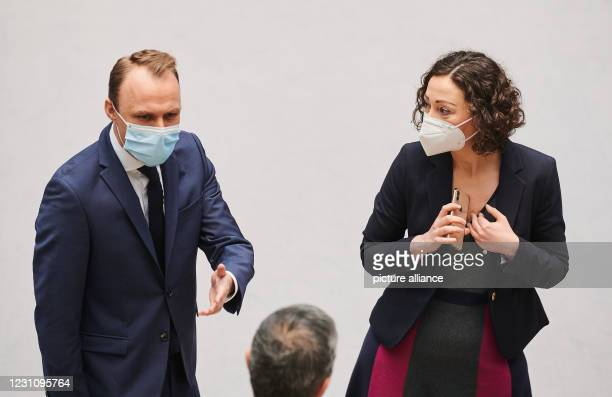 February 2021, Berlin: Sebastian Czaja , Member of Parliament, and Ramona Pop , Senator for Economic Affairs, talk with breathing protection masks...