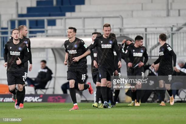 February 2021, Hessen, Darmstadt: Football: 2nd Bundesliga, Darmstadt 98 - Karlsruher SC, matchday 23 at Merck Stadium. Karlsruhe rejoice after the...