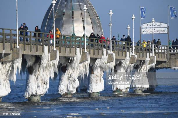February 2021, Mecklenburg-Western Pomerania, Zinnowitz: Icicles hang on the pier of Zinnowitz on the island of Usedom. The cold weather of the last...