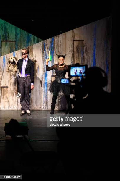 February 2021, Saxony-Anhalt, Magdeburg: A cameraman films the puppeteers Stefan Wenzel as the dog and Samira Wenzel as the cat during the dress...