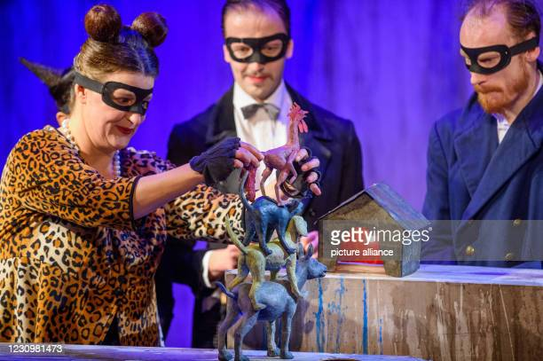 February 2021, Saxony-Anhalt, Magdeburg: Anna Wiesemeier as miller and chicken , Stefan Wenzel as farmer and dog and Lennart Morgenstern as cook and...