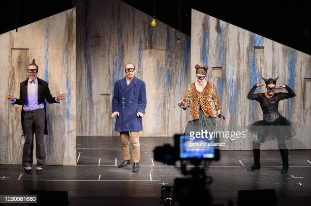February 2021, Saxony-Anhalt, Magdeburg: Stefan Wenzel as farmer and dog , Lennart Morgenstern as cook and donkey, Anna Wiesemeier as miller and...
