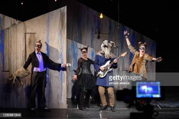 February 2021, Saxony-Anhalt, Magdeburg: Stefan Wenzel as farmer and dog , Samira Wenzel as cat and huntress, Lennart Morgenstern as cook and donkey...