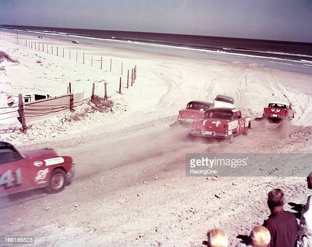 Cars exit the south turn of the Daytona BeachRoad Course during the NASCAR Cup race Tim Flock in a 1954 Oldsmobile took the checkered flag first but...