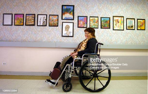 February 21 2005 / Boulder / Jill Landem a resident at the Mesa Vista Nursing Home sits next to her art work displayed on the third floor of the home...