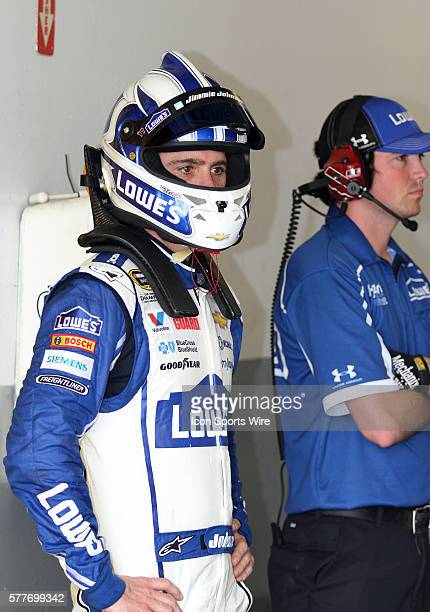 Jimmie Johnson watches his team prepare his back up car in the garage during practice for the NASCAR Sprint Cup Series Daytona 500 race at Daytona...