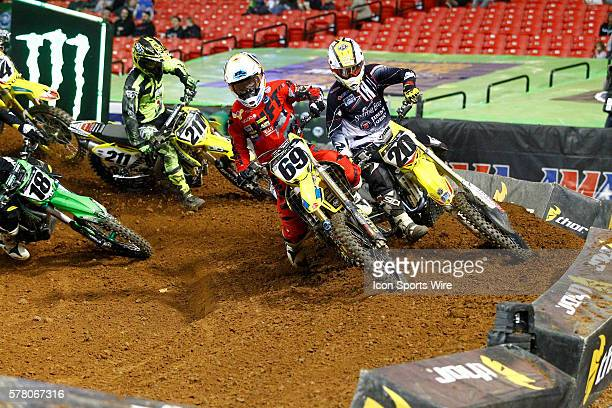 RCHSoaring EagleSuzuki 450cc rider Broc Tickle and Ronnie Stewart enter a turn together in front of a triple jump in round 8 of the AMA Monster...