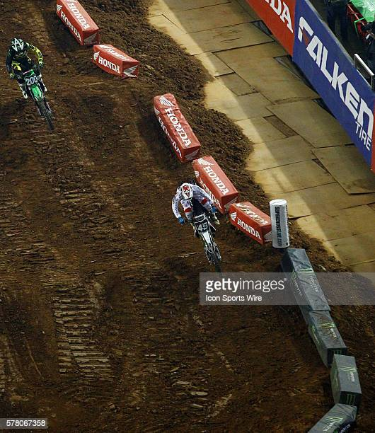 Smartop/Motoconcepts Racing 250cc rider Vince Friese enters a turn as Arnaud Tonus gives chase during his heat race in round 8 of the AMA Monster...