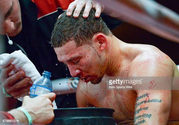 Will Madera from the USA gets cleaned up in his corner between rounds during his super middleweight bout with Randy Lozano from Mexico as part of the...
