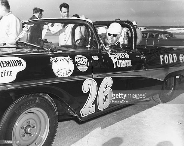 Curtis Turner gets set for the final NASCAR Convertible Division race to be run on the Daytona BeachRoad Course Turner went on to victory in the...