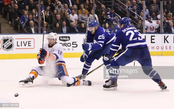 TORONTO ON February 22 In third period action New York Islanders right wing Josh Bailey makes a sliding shot but can't score to avoid overtime The...