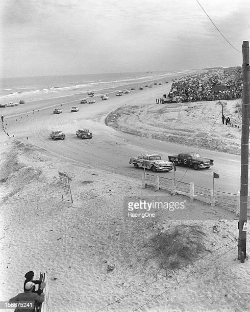 Paul Goldsmith driving Smokey Yunick's 1958 Pontiac and Jimmy Thompson in A L Bumgarner's 1957 Pontiac bring the field down for the start of the...
