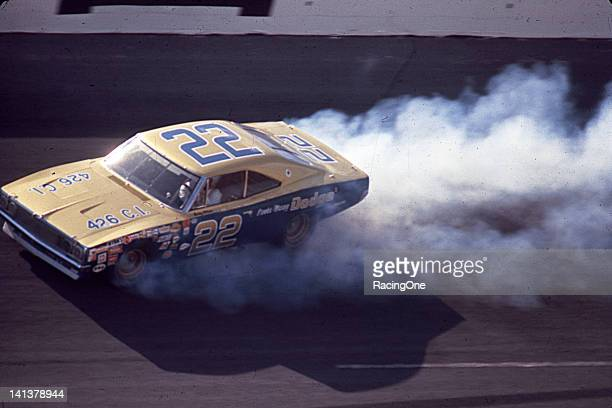 Bobby Allison was leading the Daytona 500 at Daytona International Speedway when the engine blew in his Mario Rossiowned Dodge Charger and he spun in...