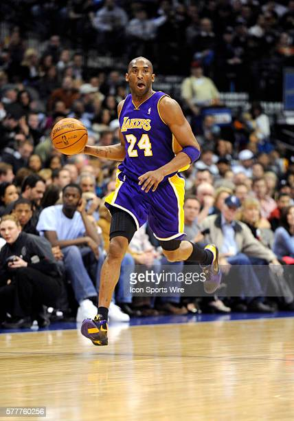 Los Angeles Lakers guard Kobe Bryant brings the ball back down the court during an NBA game between the Los Angeles Lakers and the Dallas Mavericks...