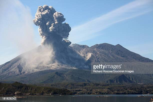 february 24, 2013 - eruption of sakurajima volcano producing ash cloud over sakurajima island with sea in foreground, kagoshima, japan. - volcanic activity stock pictures, royalty-free photos & images