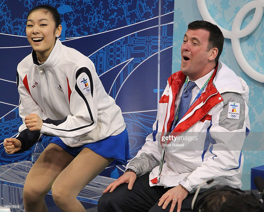 February 25, 2010 Gold medalist South Korea's Kim Yu-Na and coach Brian Orser react to her score dur : ニュース写真