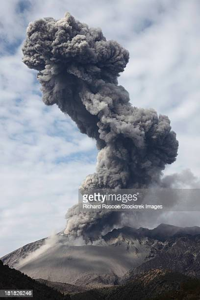 February 25, 2013 - Explosive eruption of Sakurajima volcano, Japan. Ash cloud rises high above the volcano and is bent by wind.