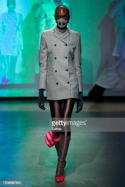 A model walks the runway during the Marine Serre show as part of the Paris Fashion Week Womenswear Fall/Winter 2020/2021 on February 25 2020 in Paris...